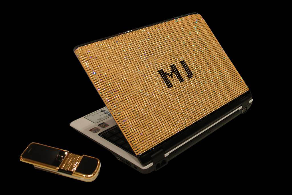 Laptop MJ Gold Swarovski Edition - Inlaid Gold Crystal Swarovski with Gold Mobile Phone. Trademark Incrusted Black Diamonds. Gift Box from Anaconda Skin.